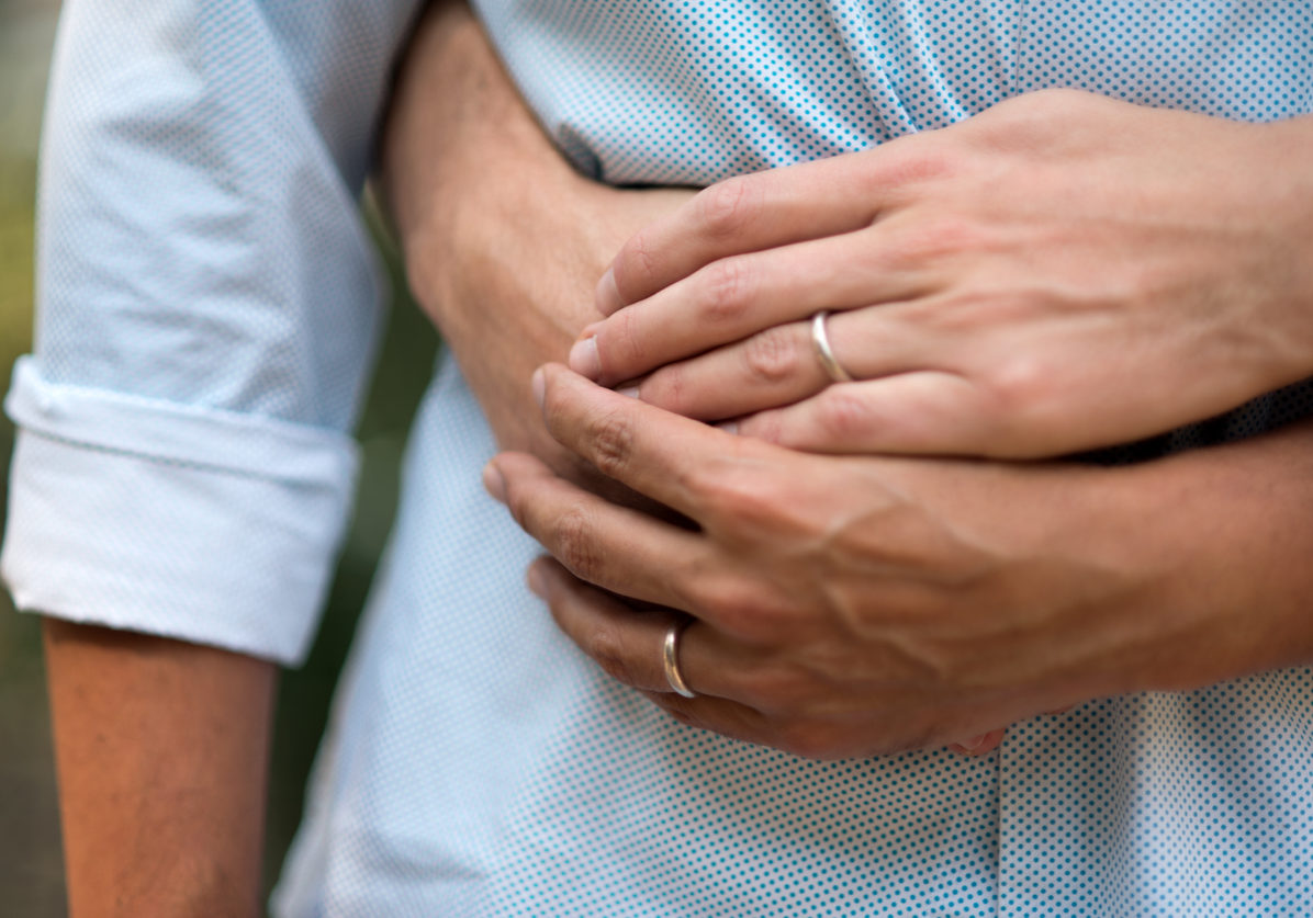 Close up of males hands with wedding ring.